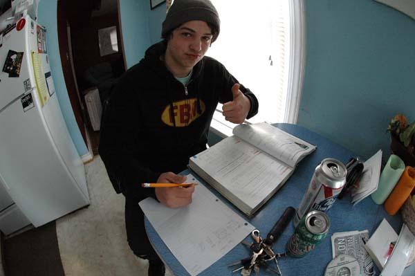 Adam Guilliams is doing school work.