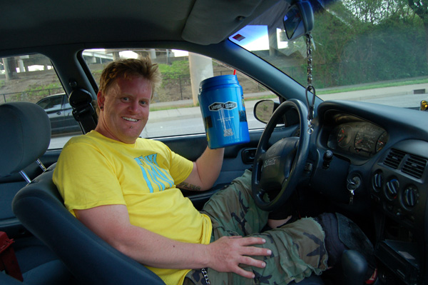 Reggie styles drinking a huge soda pop!