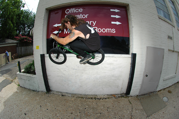 Kenny Horton, shredding high a peg grind.