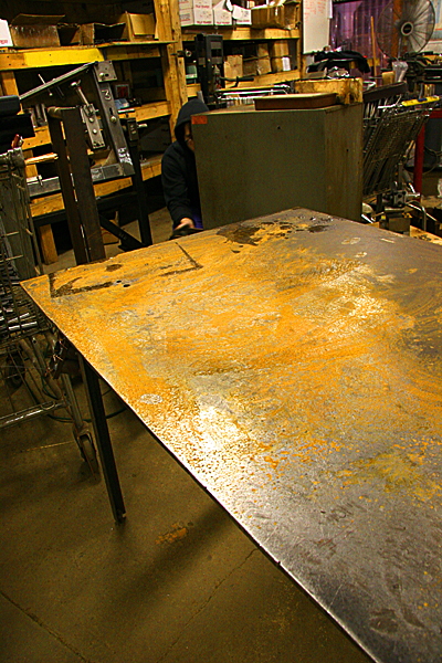 Nothing like a layer of bright orange rust on your welding table.