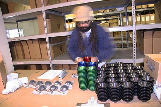 John Lee suited up for the cold, cold task of hubguard packaging.