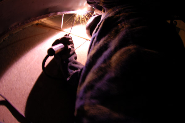 John Corts stick welding the bus back together.