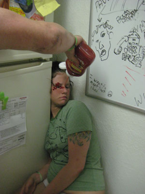 Is this guy squirting ketchup in that girls face?