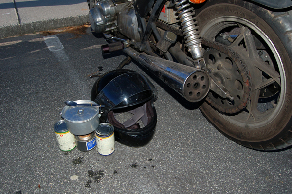 Cooking soup, helmet as a windshield....