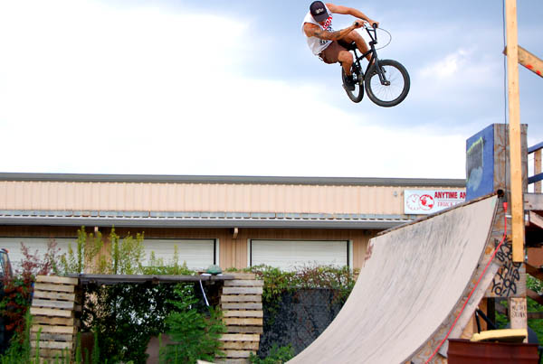 Jumping the dubbs on the half circle wooden pump track- Evan V.