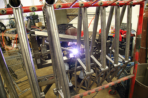 Dudes welding and frames on racks, it's what we do.