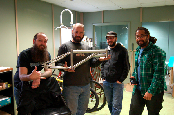 4 stoked dudes with beards and a bike for Chad Herrington