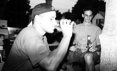 Random photo of Losey and Brad Mcdonald drinking Moonshine on My porch...