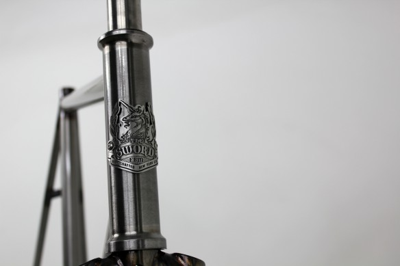 FBM-Sword-SQ-Clear-Headbadge-584x389